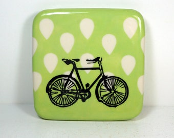 tile with tinda green background and a Dusty Road Bike print, ready to ship