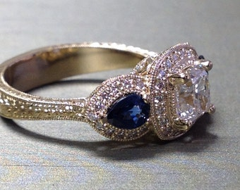 Diamond and blue sapphire three stone engagement ring