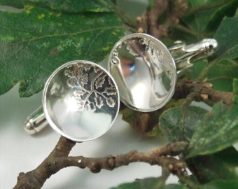 Silver Cuff links: Sterling silver cuff links with an oak leaf pattern imprinted.