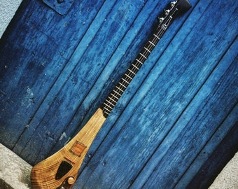 Electric 3-string guitar by DaShtick guitars. Handcrafted Celtic diddley bow. CBG