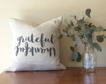 The 'GRATEFUL THANKFUL' cushion cover. Flip it!