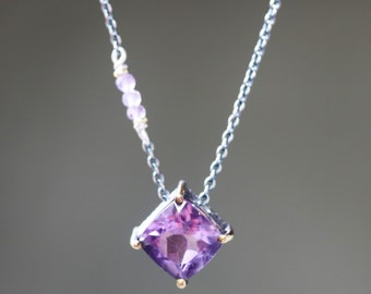 Amethyst princess cut pendant necklace in silver bezel and brass prongs setting with tiny amethyst on the side on oxidized silver chain