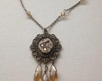 Brass steampunk necklace with orange crystals