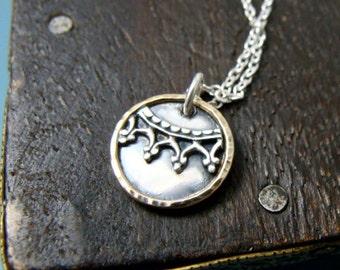 mixed metal relic pendant
