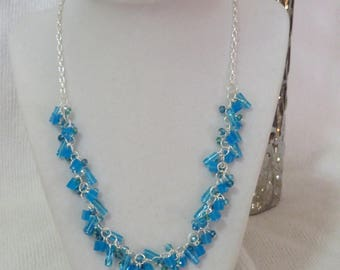 Blue glass and crystal cluster necklace