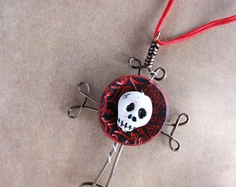 Skull Cross with black and red disk by Marie Segal