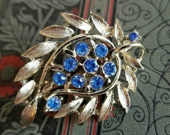 Vintage blue rhinestone brooch pale gold tone