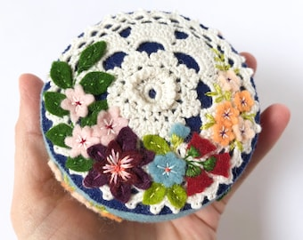 blue felt pincushion with vintage style cotton doily and lots of hand embroidery