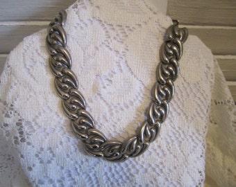 Vintage necklace swirl chain pattern