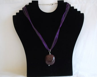Ribbon and cord necklace with large pendant