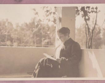 Antique soft focus photo, peaceful woman reading, early 1900s, historical, snapshot, book, outdoors, sunny, womens studies, womens history