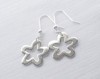 Sterling silver polished flower drop earrings