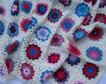 Multicoloured granny circle crochet blanket