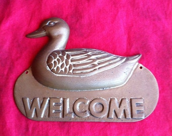 A Brass Duck Welcome Sign Made In Taiwan