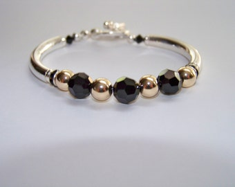 Made with sterling and swaroski crystal beads