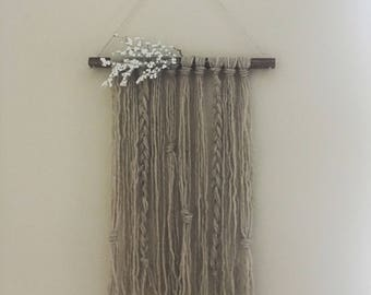 """28"""" x 12"""" boho light gray wall hanging with braid and white floral detailing"""