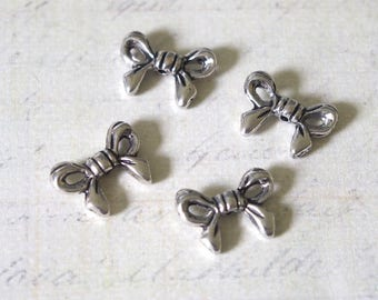 4 beads 14x10mm silver bowtie