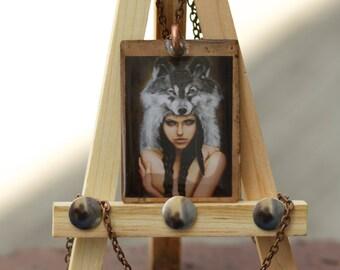 WolfGirl pendant on copper. dimensions: 1.25x1.5 in.
