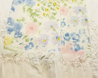 Pretty watercolors and ruffles. Twin flat sheet and two matching pillowcases.