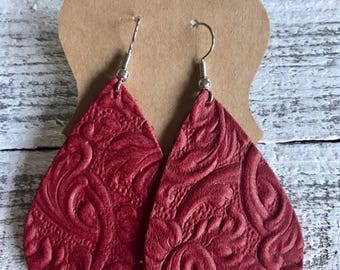 Red floral embossed teardrop leather earrings
