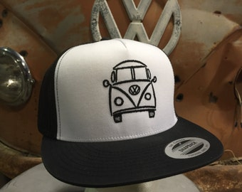 VW Bus Classic Snap Back Hat.  Structured 5 panel front with embroidered Split Window Bus design.  Mesh back with classic snap clasp.