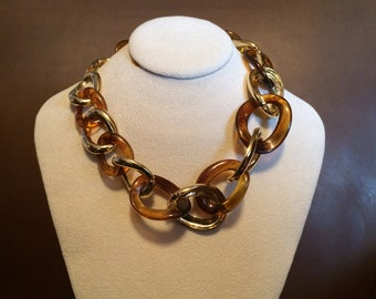 Kenneth J Lane neckpiece. Faux amber and gold plate .
