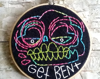 "pink & green GET BENT skull - 4"" hand embroidered wall hanging"