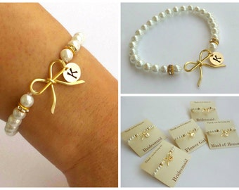 Free Shipping. Set of 5 Personalized gold-filled bow bracelets with pearl beads. Bridesmaids bracelets, initial bracelet.