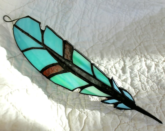 https://www.etsy.com/listing/569704512/custom-made-stained-glass-feather?ref=shop_home_feat_2