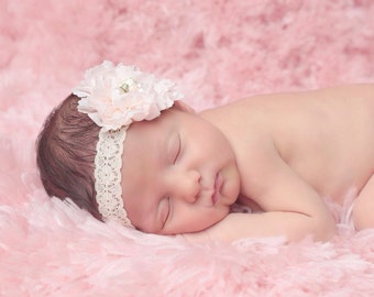 Light peach ruffle flower on stretch lace with pearls and a satin rosebud in the center, perfect for newborn's by Lil Miss Sweet Pea