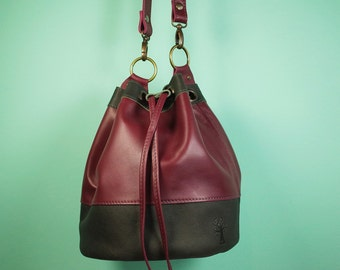 Ruby and dark grey leather Bucket Bag, (W19 x H23 x D19 cm), zipper pockets and 2 inner pockets