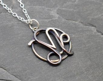 Leo capricorn zodiac necklace sterling silver and copper oxidised