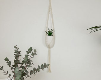 Macrame plant hanger with ceramic pot