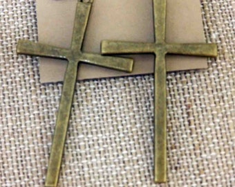 Antique gold cross slender earrings.