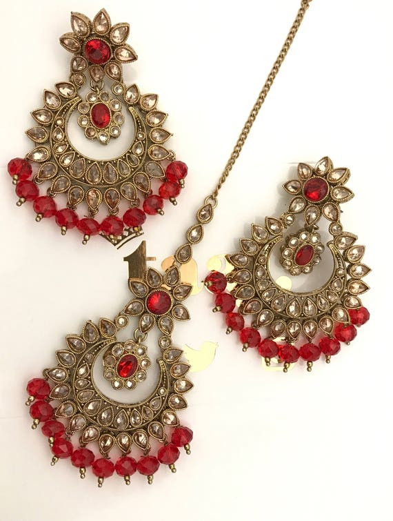 Sejal Antique Gold, champagne gold and red zirconia earrings and tikka set