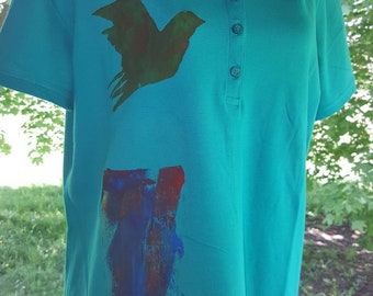 Laura Scott Woman's Golf polo screen printed with a little bird utilizing enviromentally safe inks and zero waste byproduct