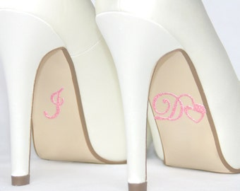 I do shoe stickers pink heart