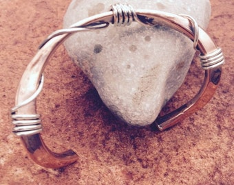 Forged copper cuff bracelet with sterling wire wrap.