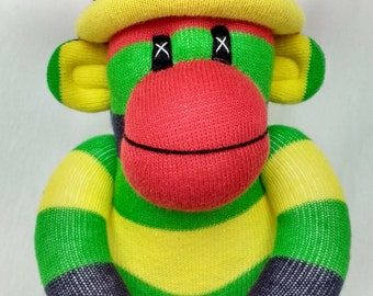 Little sock monkey yellow, green and blue with rainbow pom pom hat