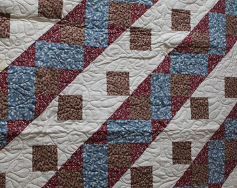 Patchwork twin or large lap sized quilt.  Perfect for the couch.