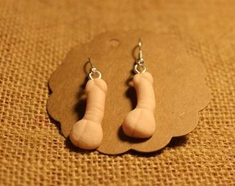 White penis earrings