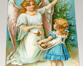 Antique Postcard Germany Christmas Embossed Beautiful Angel and Girl decorate Tree