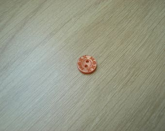 small orange Pearly button shape round with inscription