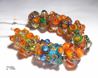 FIESTA Handmade Lampwork Bead Set in Red Blue Turquoise Green Yellow Orange  Silver Set of 11