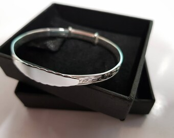 Solid Silver bangle, perfect for christenings. A gorgeous and elegant gift. Complete with gift box. Engraved with a name & date.