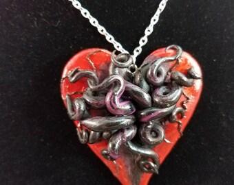 Devoured heart pendant