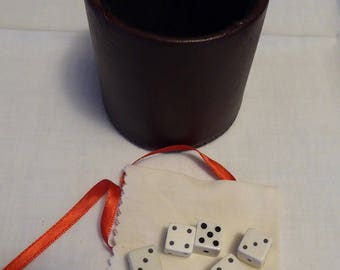 Leather dice cup, 5 dice, game booklet, black velvet interior