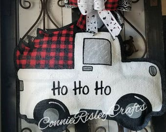 Buffalo plaid Christmas tree in an old time white truck