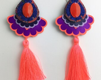 NEON TASSEL EARRINGS in fluoro red and purple. Festival Jewellery Collection. Statement earrings. U.V. Reactive jewellery. Colourful.