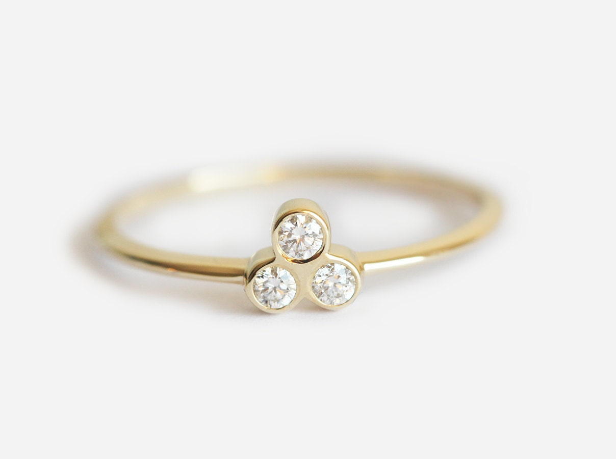 product charm diamond white stone centres three ring gold